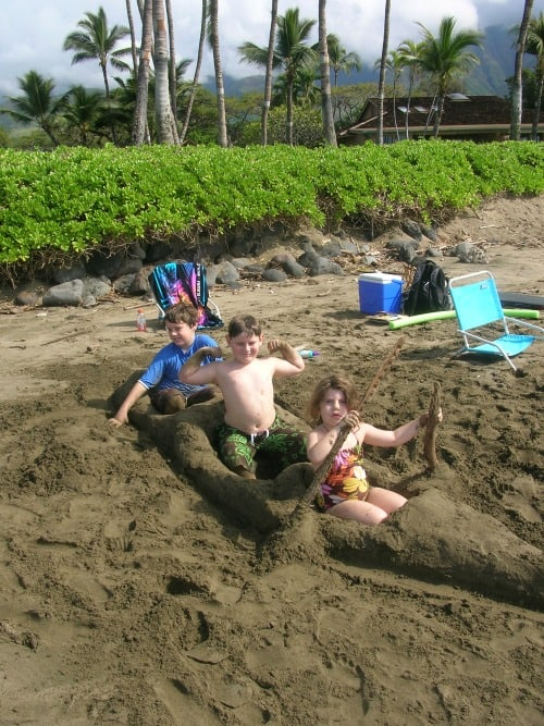 Playing at the beach in Hawaii is a great way to engage a family with children who are young.