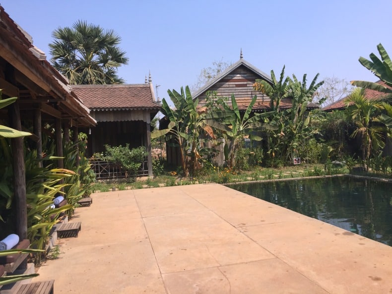 The pool, lounge chairs, and a couple of the bungalows at the hotel in Siem Reap.