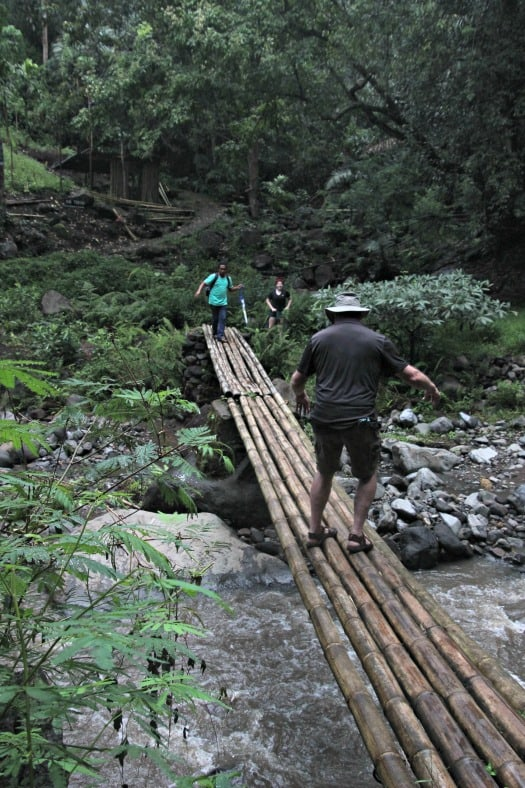 Crossing the bridge near the Indonesia waterfall