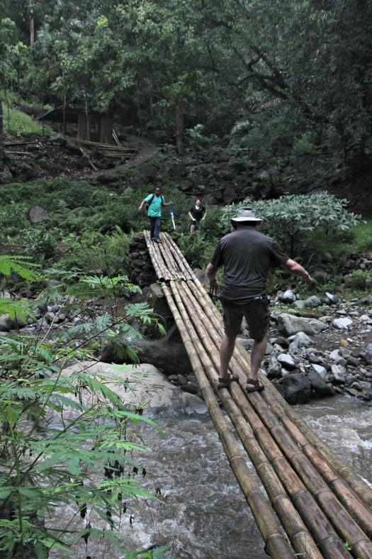 Crossing the bridge near the Indonesia waterfall