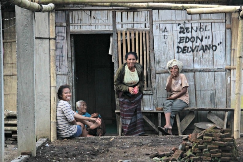Women outside their home near Indonesia Volcano